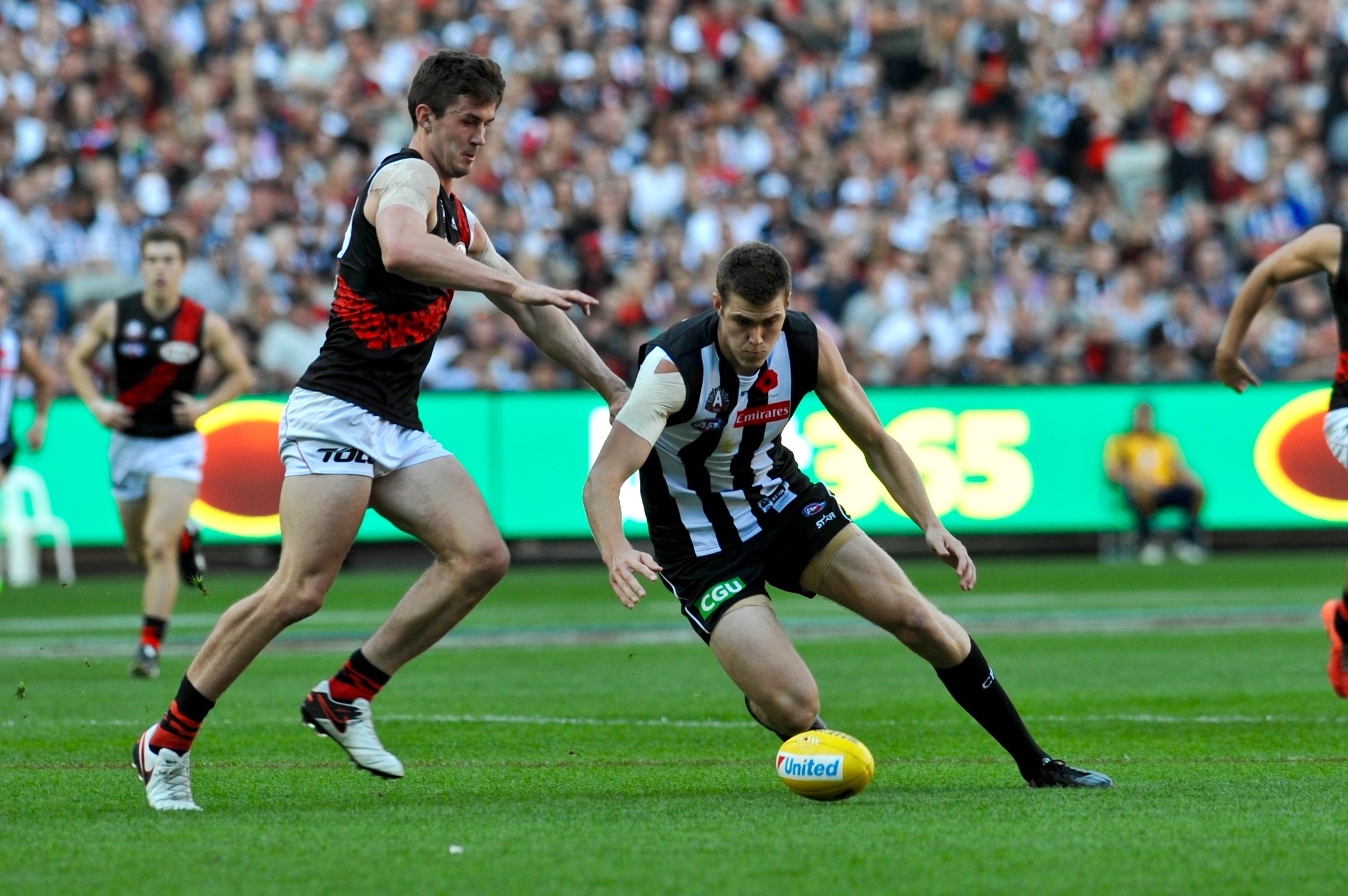 Mason Cox goes for the ball. Photo by Kim Densham for AFANA.
