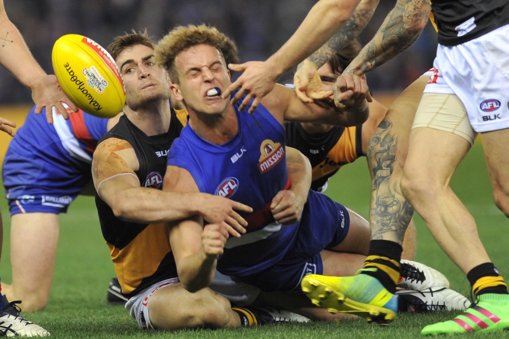 Im the AFL weekend action, Anthony Miles catches Mitch Wallis. Photo by Kim Densham for AFANA.