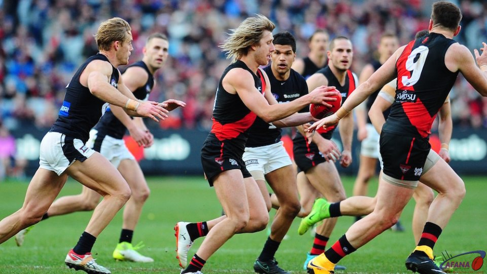 Dyson Heppell weaves through midfield traffic