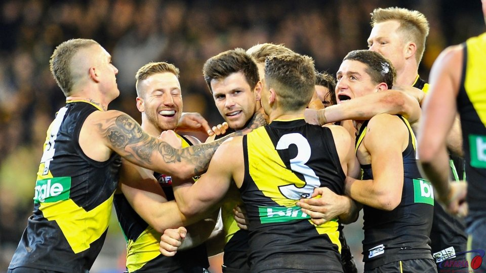 Tigers rush to congratulate Trent Cotchin on a captains goal