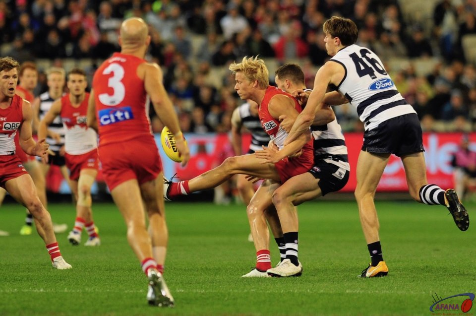 Heeney clears under massive pressure from the Cats midfield