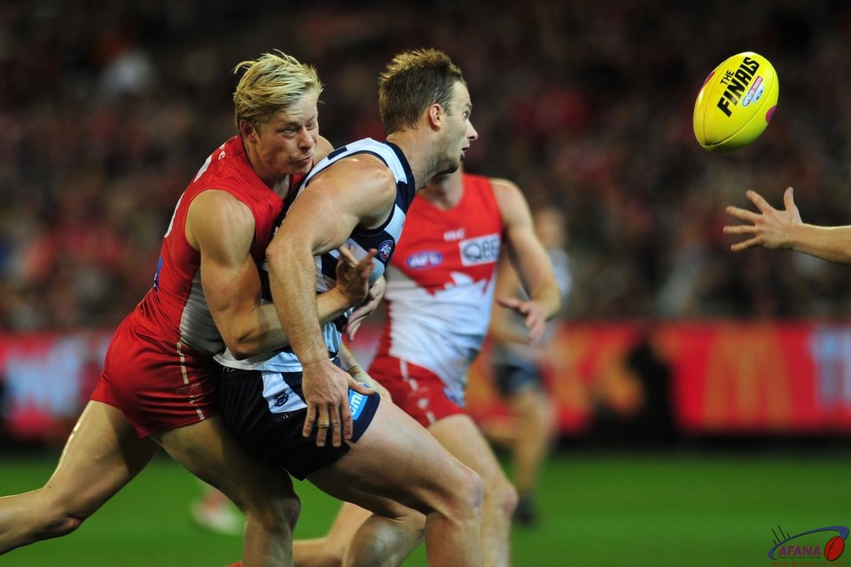 Heeney tackles Henderson