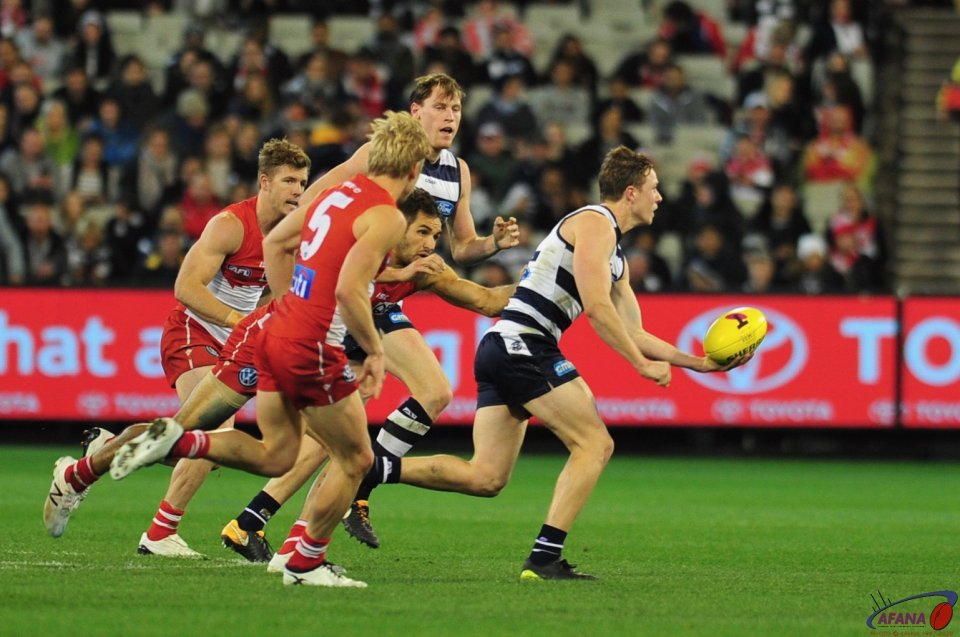 Scott Selwood breaks away from Kennedy and Heeney