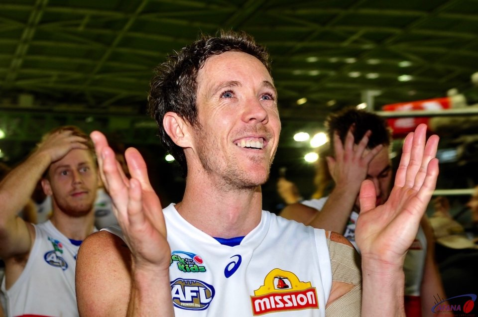 A jubilant Bulldogs skipper Bob Murphy applauds the fans after the win