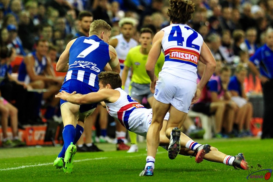 North Melbourne captain Jack Zeibell (7) evades the bulldogs tackle