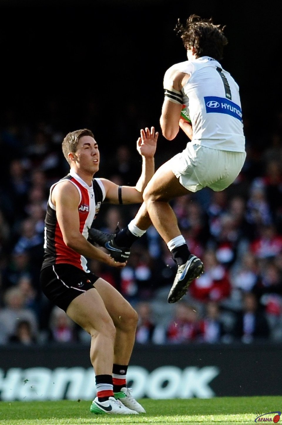 Jack Silvagni takes a flying defensive mark as Jade Gresham contests