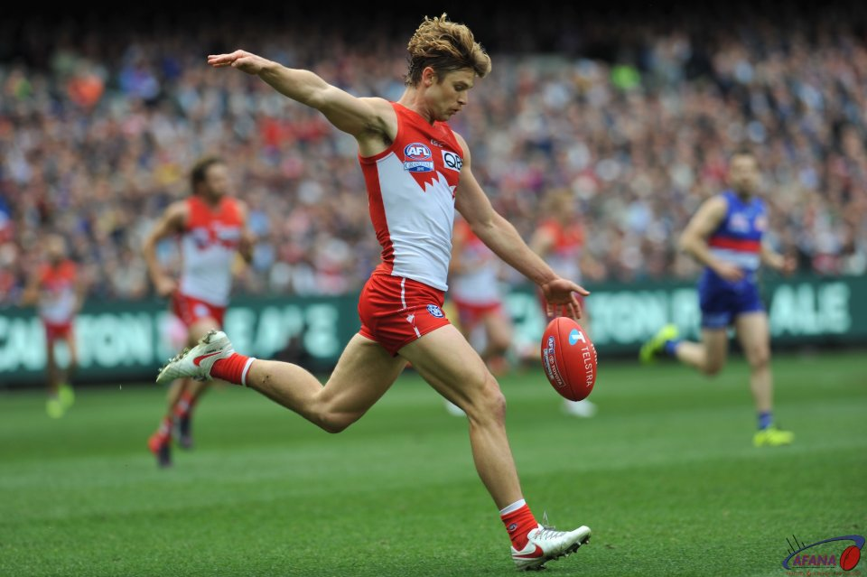Rampe clears from the Swans backline
