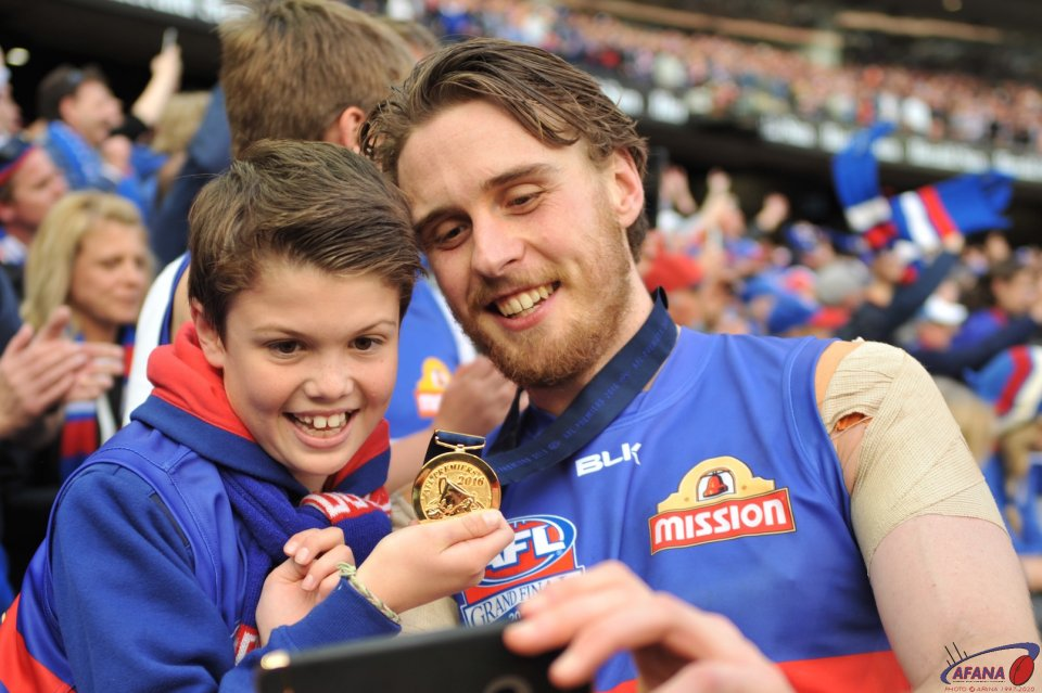 Roughead shares the moment with a young fan