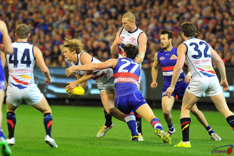Sloane tackled by Minson