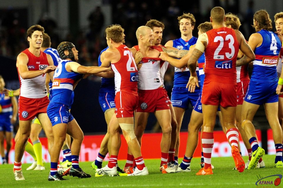 Zak Jones get some feedback on his Cloke bump as the Dogs give it to him
