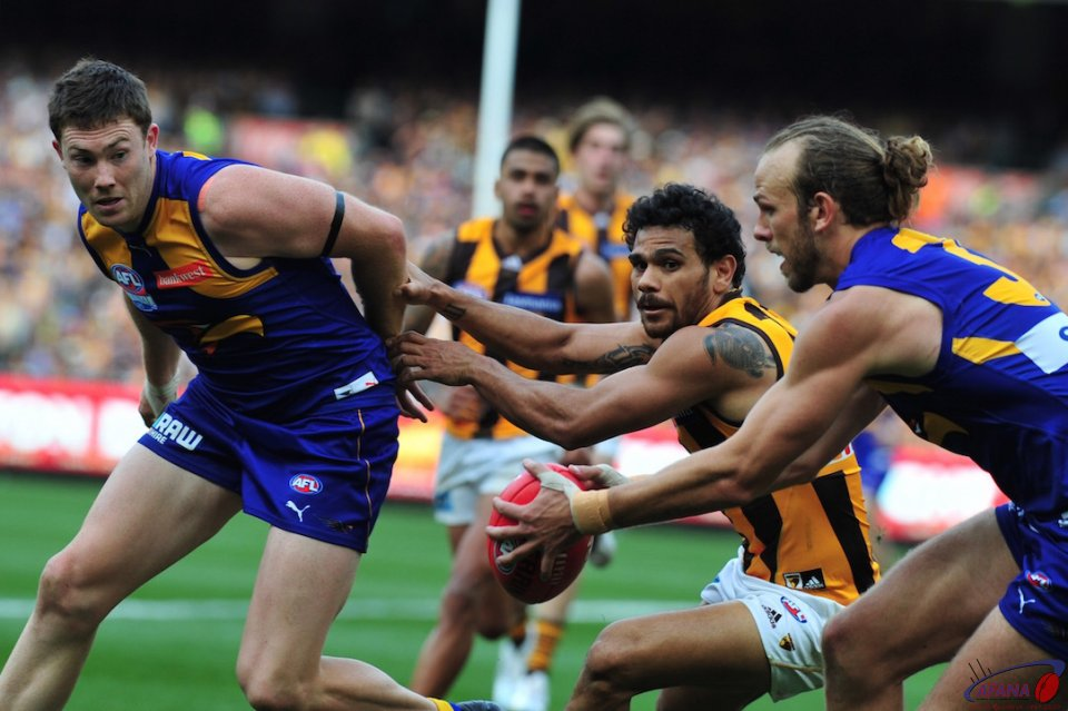 Schofield grabs the ball as McGovern sheppards Rioli