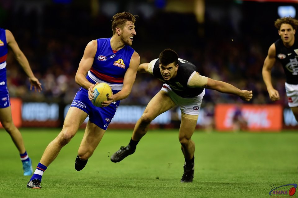 The Bont turns Kennedy inside out , turns and drives the ball forward.