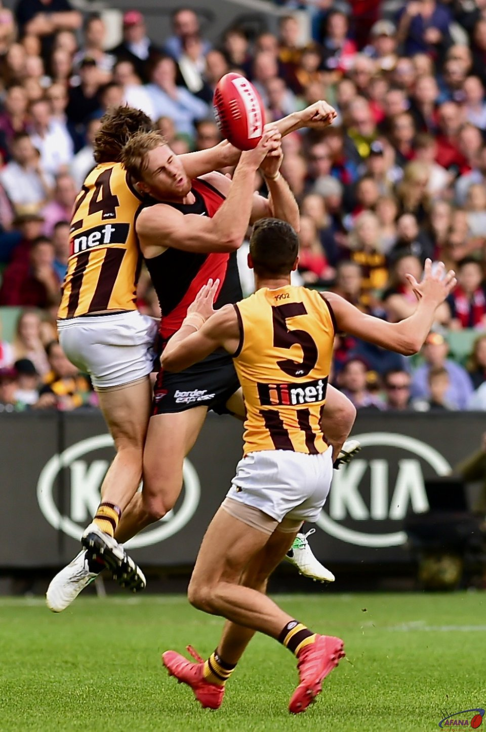 Ben Stratton spoils James Stewarts mark with Ryan Burton (5) in support