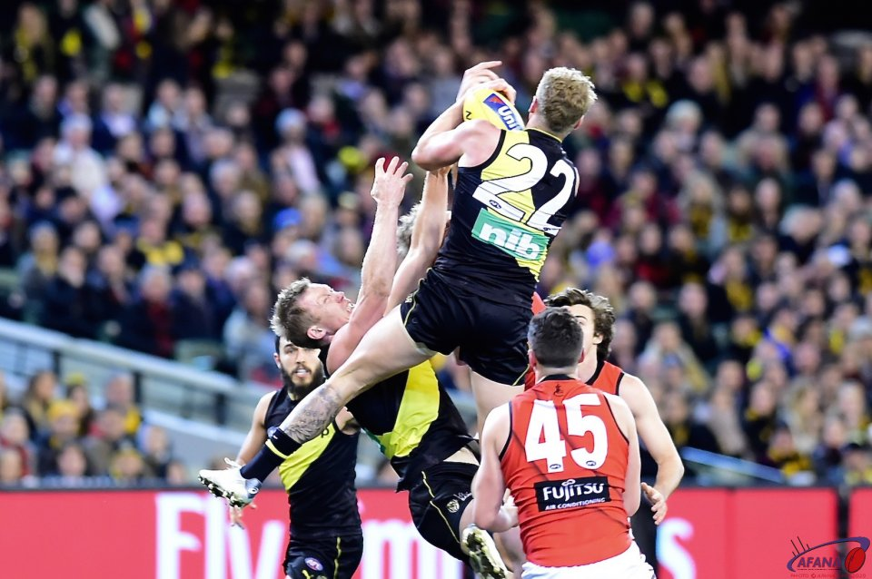 Josh Caddy takes a contested mark.