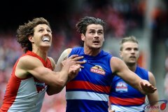 The ball in contest as Boyd and Tippett duel for position