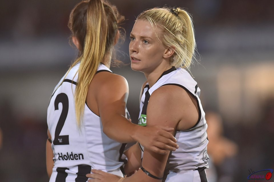 Chloe Molloy (2) and Kristy Stratton comfort each after another opening loss to Carlton