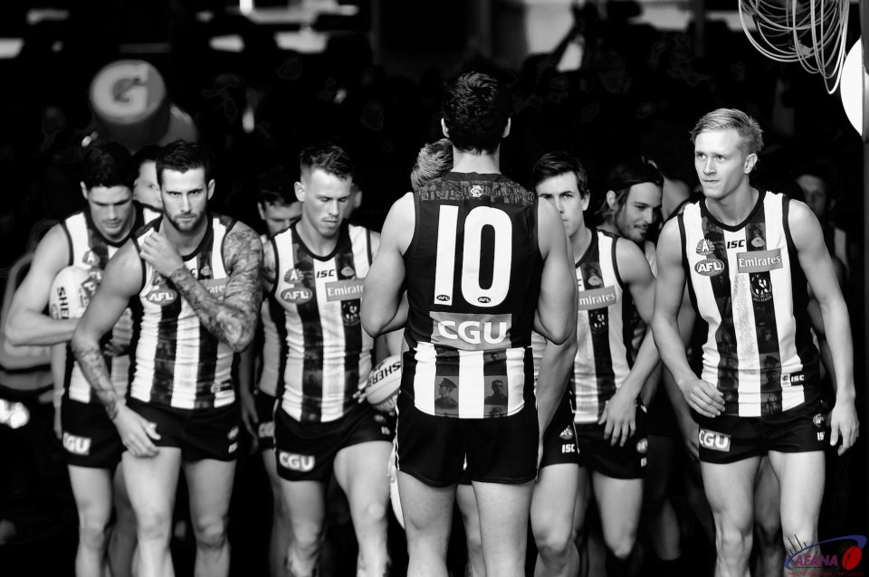 The Pies form up in the players race before the game