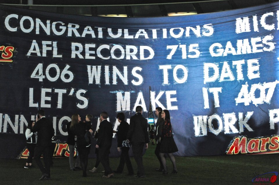 Michael Malthouse walks to the Blues banner prior to his record breaking game