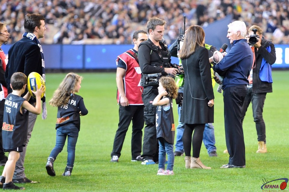 Christy Malthouse inteviews Mick on his 715 game record surrounded by grandkids
