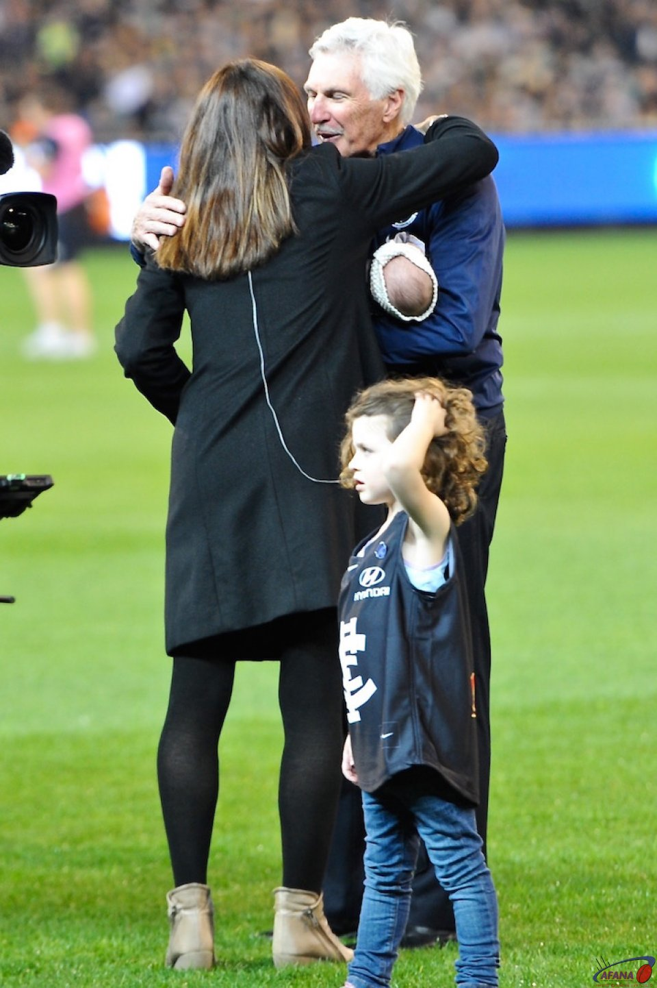 Christy Malthouse gets a hug from Dad
