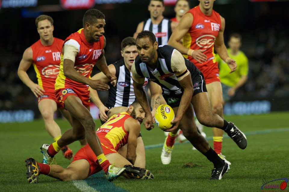 Travis Varcoe clears the ball in as Adam Saad and Touk Miller contest