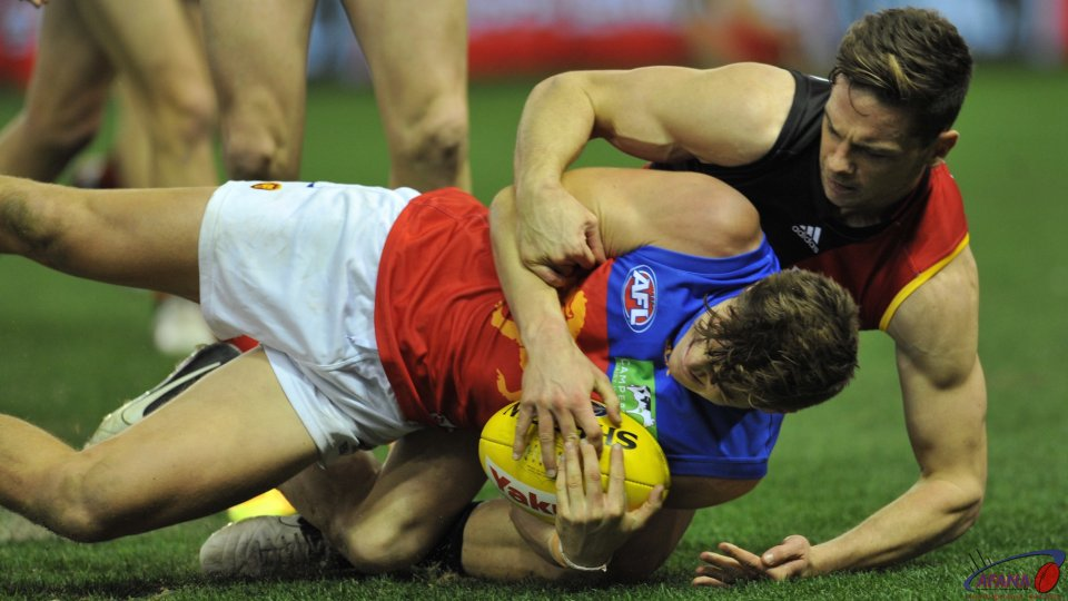 Ambrose and Rockliff contest the ball