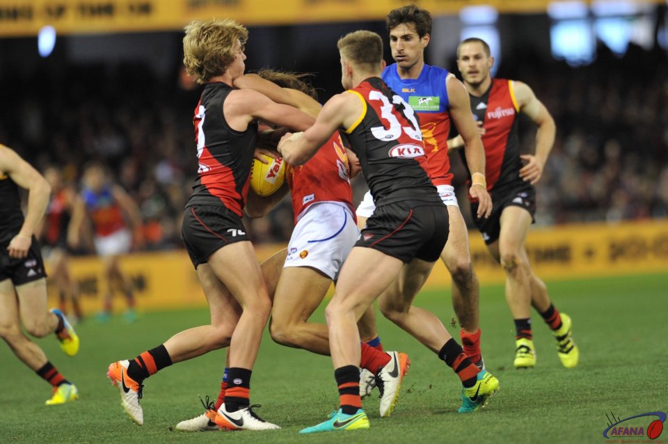 Darcy Parish and  Jayden Laverde tackle Rhys Mathieson