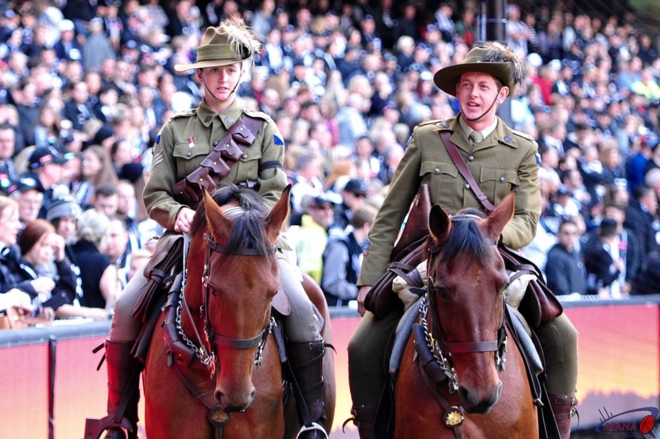 ANZAC horses lead the cavalcade of veterens around the arena