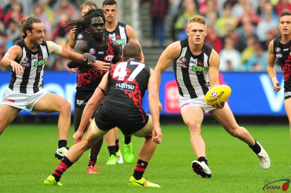 Pops Kelly (47) lines up Adam Treloar as he prepares to handball