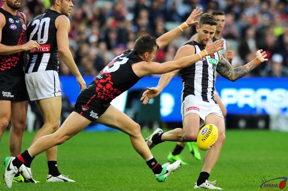 Ramsay clears as Fantasia keeps the forward pressure on the Pies defenders
