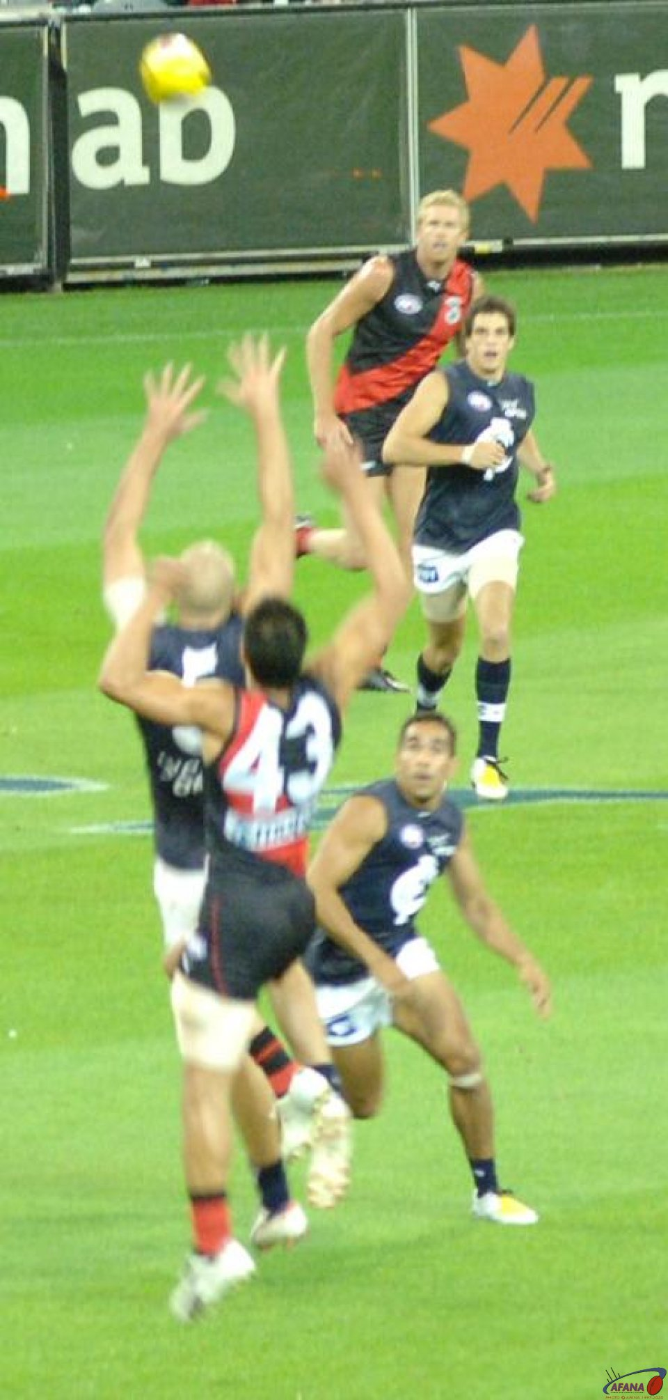 Mal Michael taking a mark for Essendon against Chris Judd of the Blues