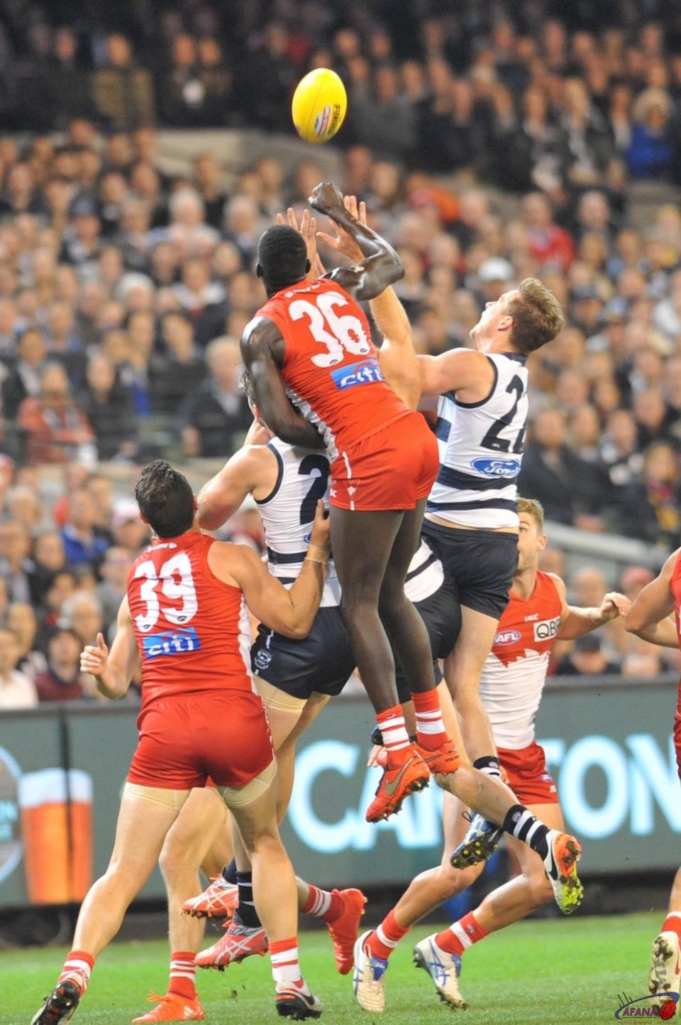 Aliir Alir above the pack spoils the long ball in
