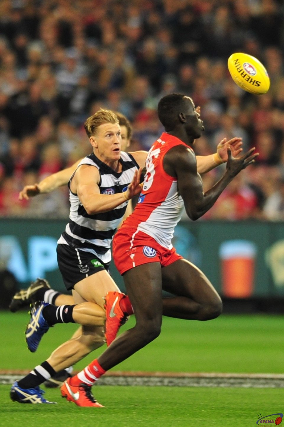 Aliir bursts through running the ball out of the Swans defence