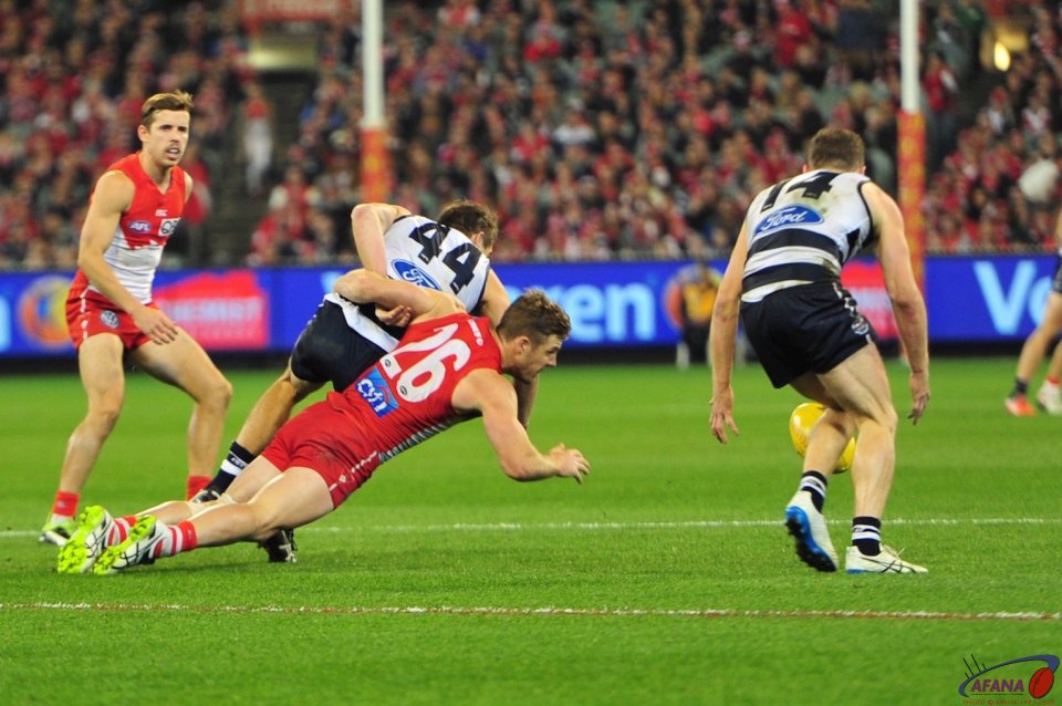 Luke Parker tackles Corey Enright as the ball spills to Joel Selwood