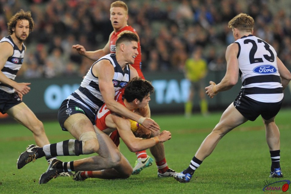 Zak Smith tackles George Hewett as Josh Caddy waits for the crumb