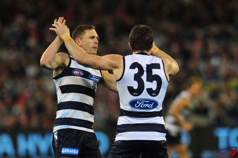 Selwood and Danger celebrate the opening Cats goal