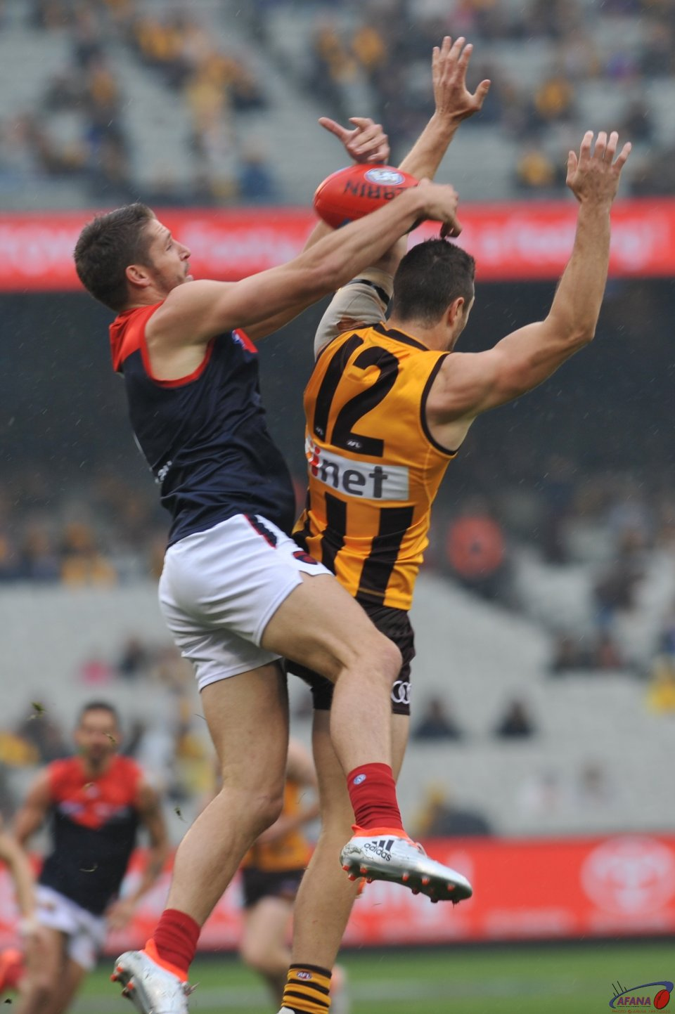 Jesse Hogan and James Frawley contest the incoming ball