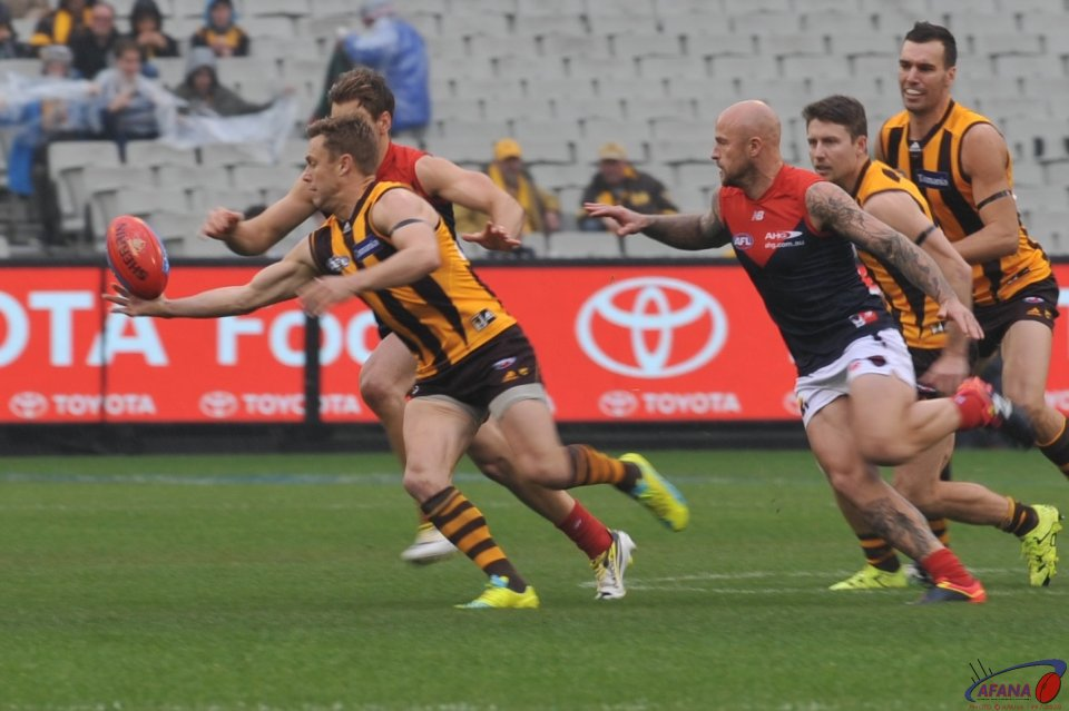 Sam Mitchell reaches for the ball as Nathan Jones prepares to tackle