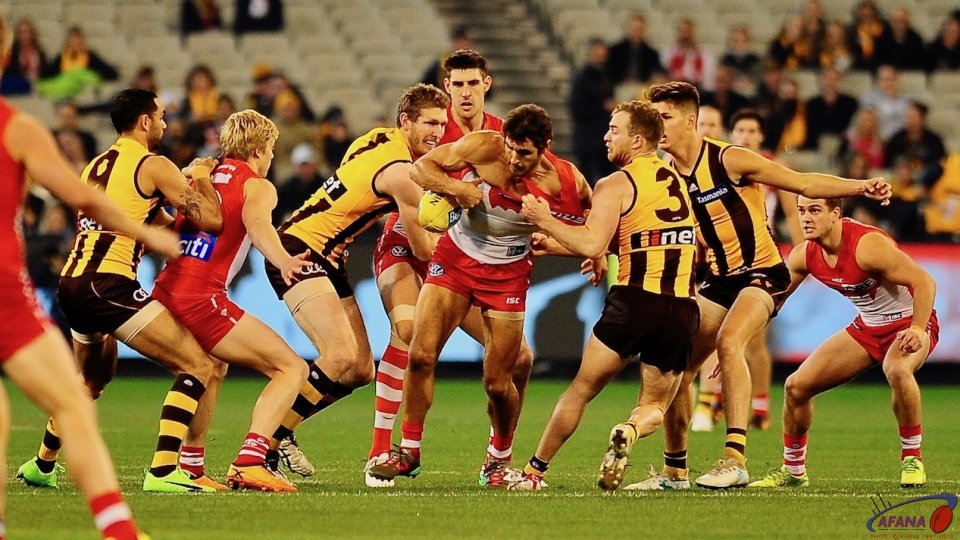 Josh Kennedy oplaying his 200th game gang tackled_4167