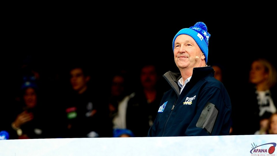 Neale Daniher watches the Olympians go down the slide_1124