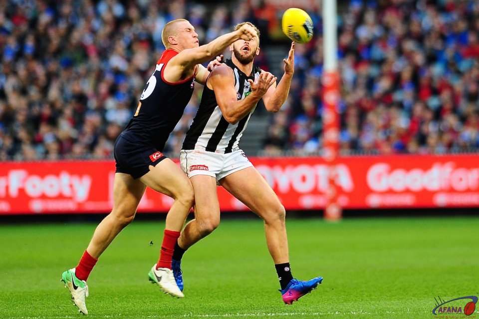 Tom McDonald gets a fist in to spoil the mark