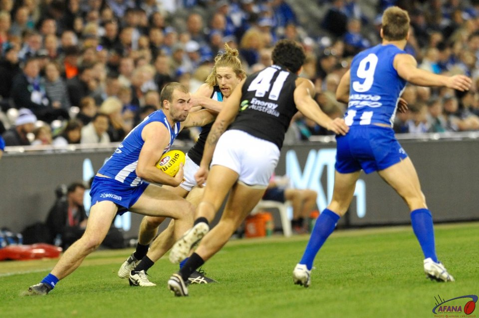 Aaron Young gets a Ben Cunnington stiff arm