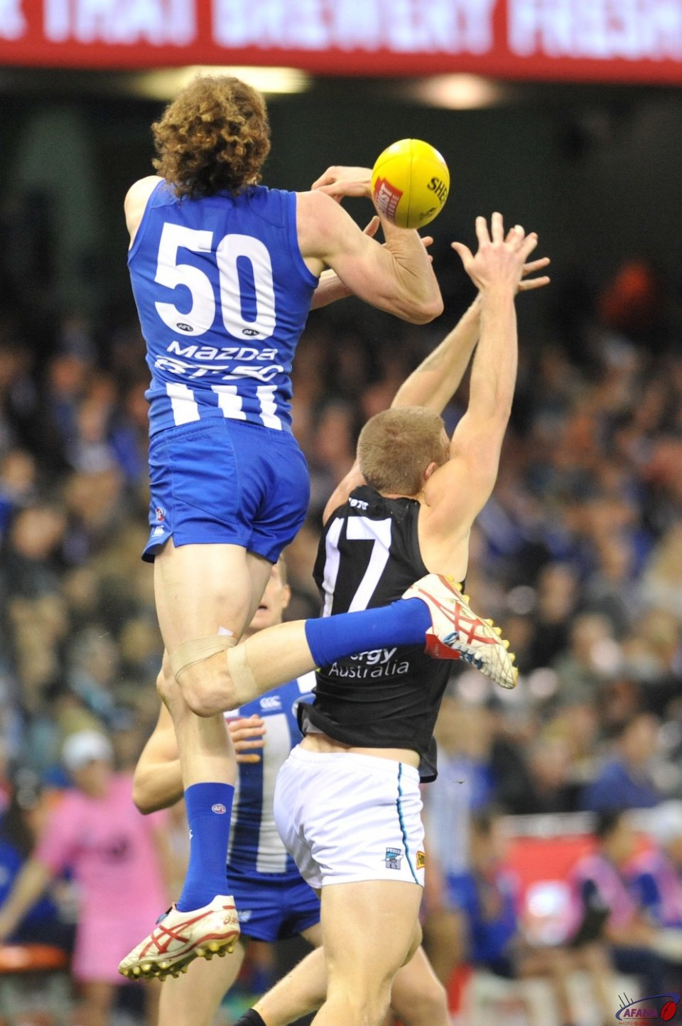 Ben Brown gets some air over Tom Clurey