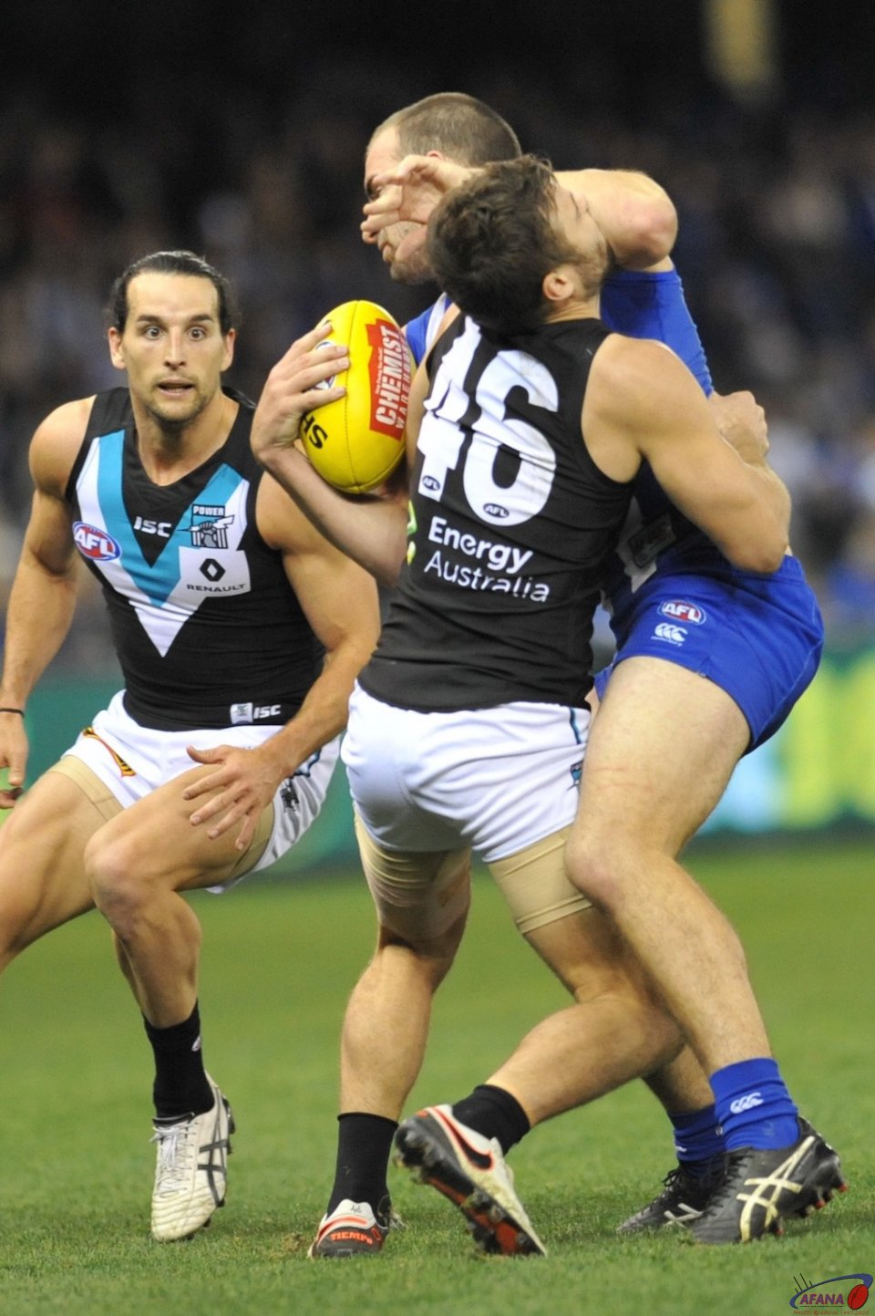 Ben Cunnington gives Sam Gray a solid fend off