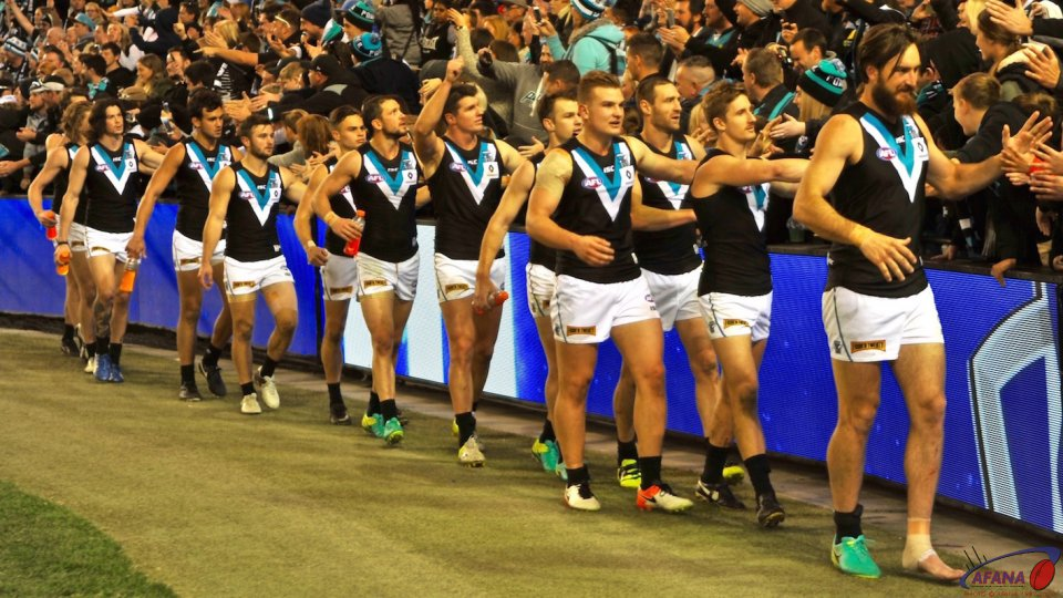 The Power boys thanks their travelling fans after defeating North Melbourne