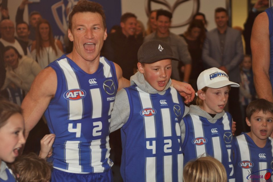 Brent Harvey and his family belt out the North Melbourne song in the rooms after the game