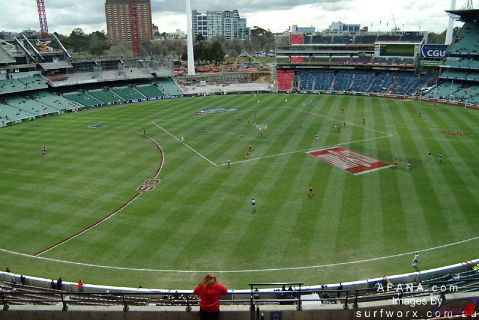 The Melbourne Cricket Ground viewed from the stands.  The portion under reconstruction visible in the distance.