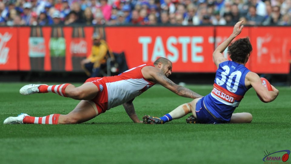 Hamling defends as Buddy lunges to get the ball