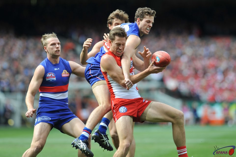 Laidler feels the bulldog house as Jack McCrae defends