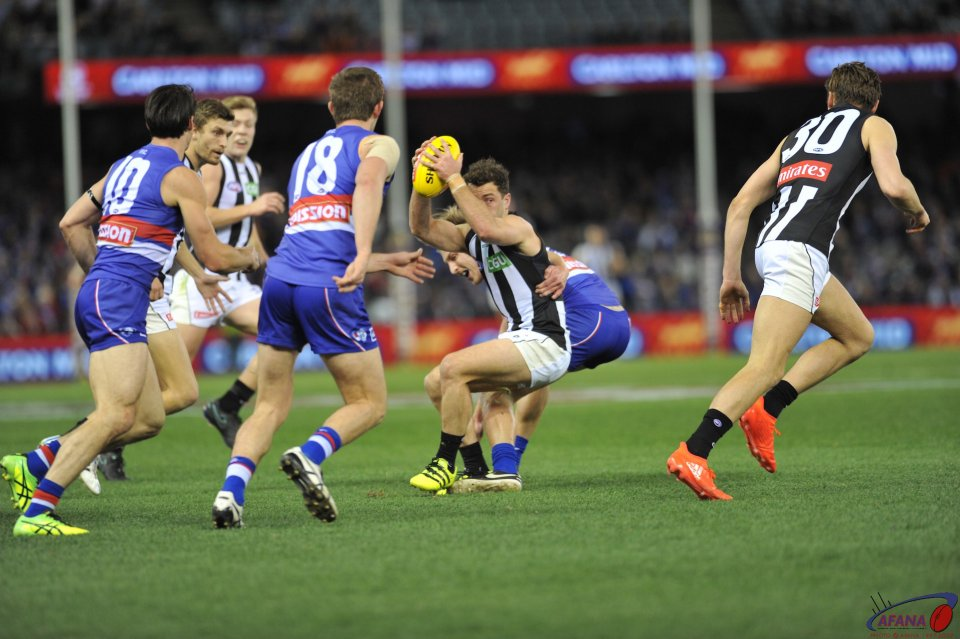 Bulldogs stop another Magpie attack as Jarryd Blair attempts to evade a tackle